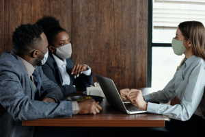 business-people-wearing-face-masks-and-talking-4427926.jpg